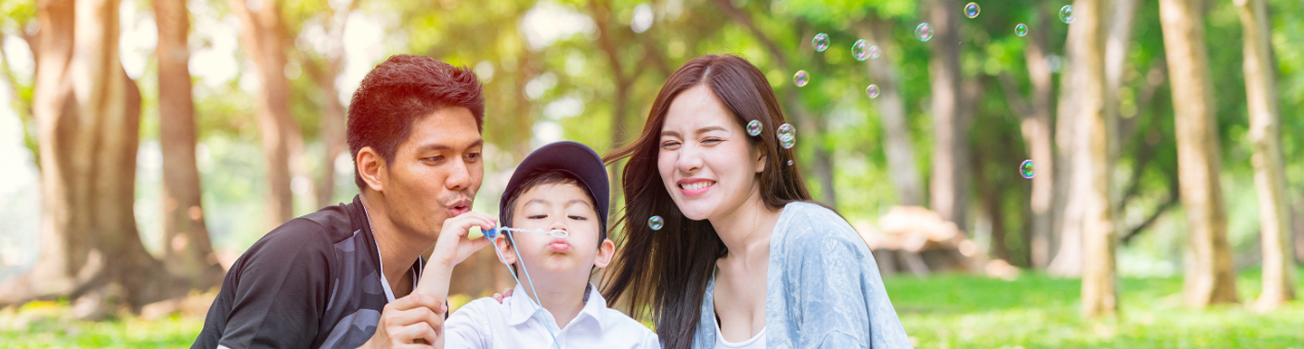 Asian family blowing bubbles